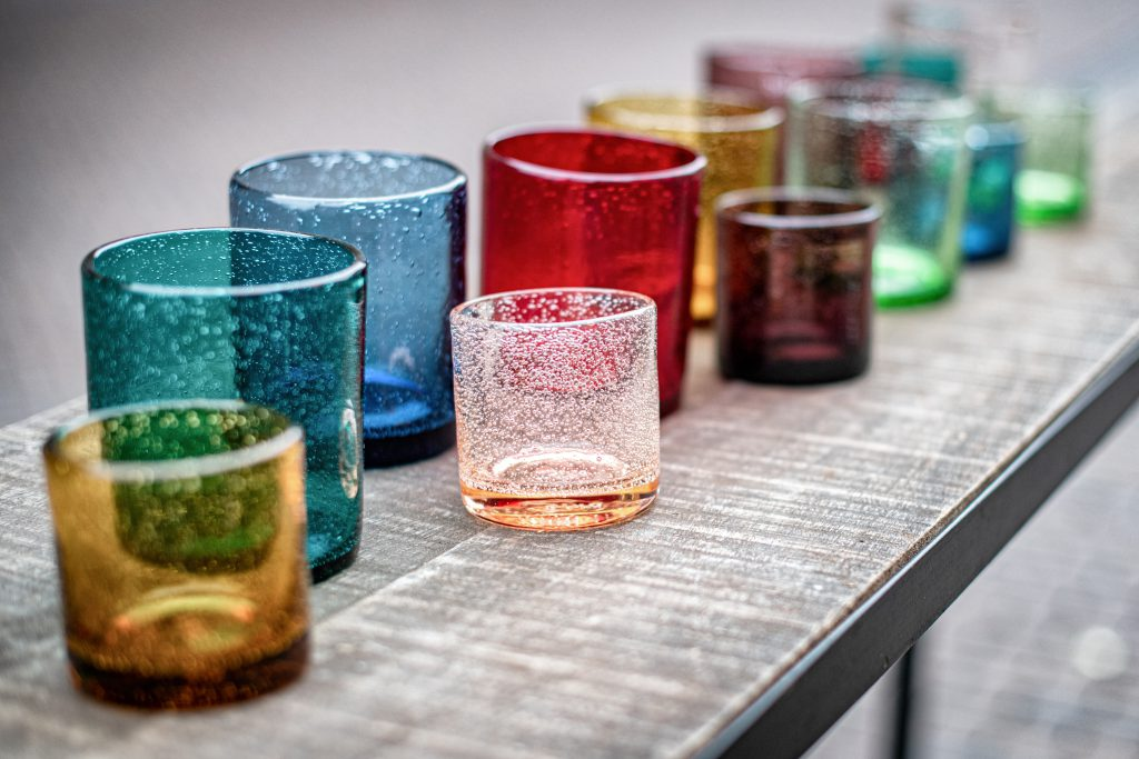 Small candleholders on a table in different colours